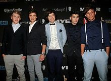 """Quel membre du groupe """"One Direction"""" a quitté le groupe en mars 2015 ?"""
