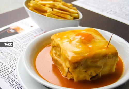 "The famous dish ""Francesinha"" is typical of which Portuguese city?"